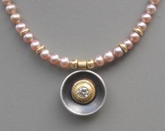 Diamond pendant on pearl necklace
