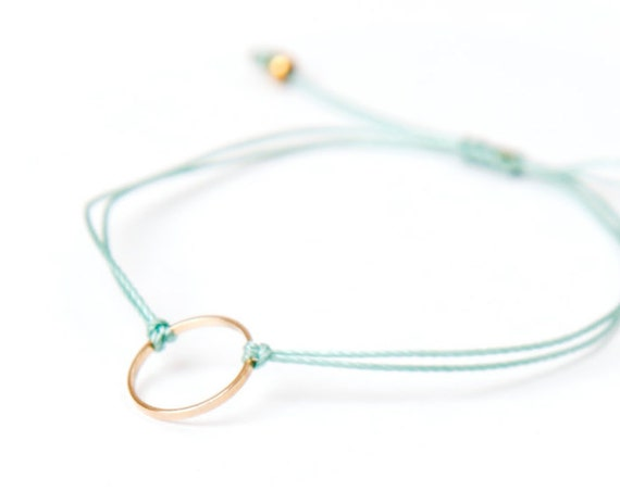 Delicate gold ring bracelet on a nylon thread handmade in Montreal