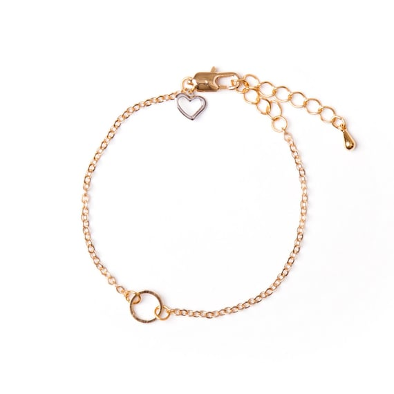 Gold-plated bracelet with small ring charm handmade in Montreal