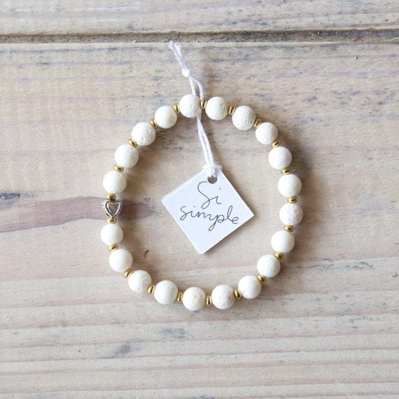 Bracelet white coral beads on elastic thread handmade in Montreal
