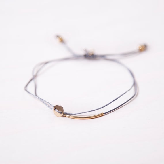 Delicate gold-plated bracelet on a nylon thread handmade in Montreal
