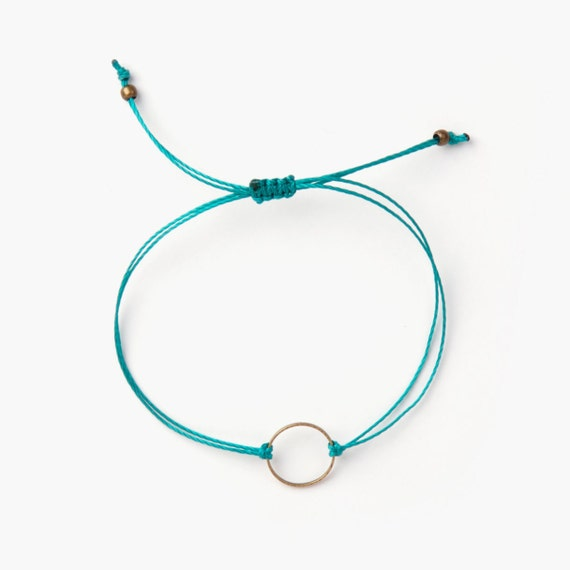 "Delicate gold ring ""marilou"" bracelet on a nylon thread handmade in Montreal, Canada"