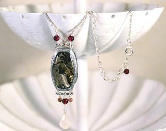 Rosealia's Timestop - resin, garnet, and tourmaline steampunk necklace