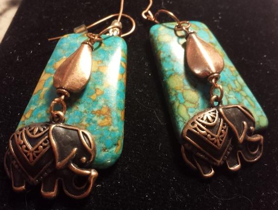 Large Copper Elephant Earrings on chunky stone