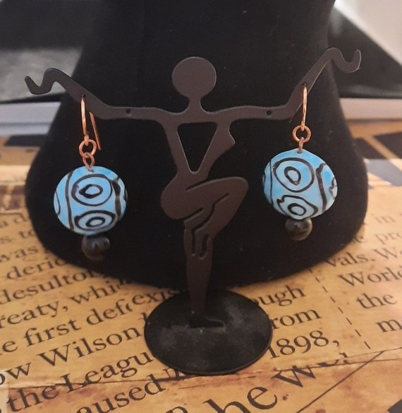Lampwork disk with geometric designs earrings