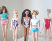 Barbie swimsuit reproductions similar to the original black and white Barbie suit, and the Midge two-piece suit.