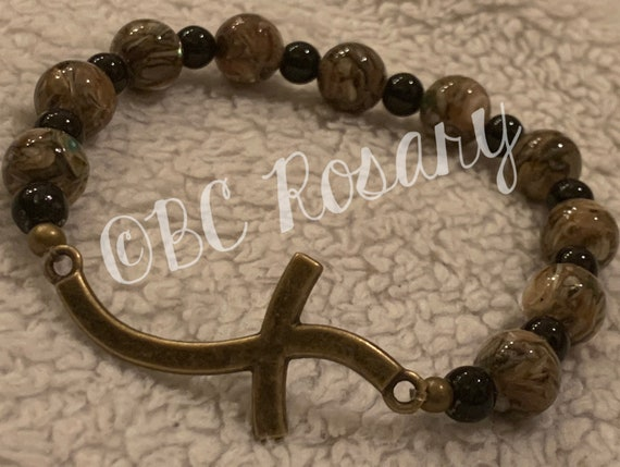 Bronze Curved Cross Fossil Stone Stretch Bracelet