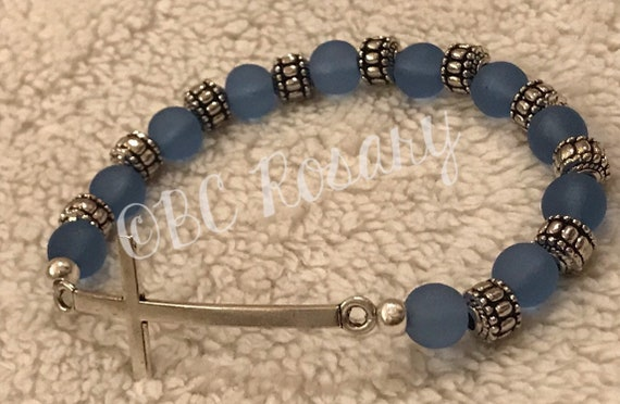 Silver Cross Blue Stretch Bracelet