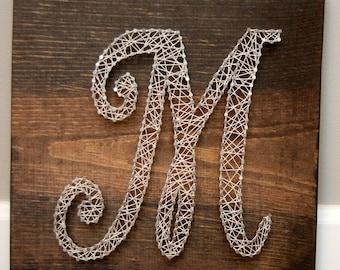 Letter m nail art