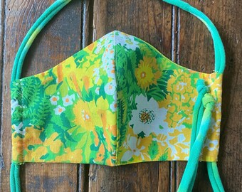 Womens/Teens reversible mask from vintage sheet 60's fabrics in  floral cottons with green and yellow colored tshirt cording tie.