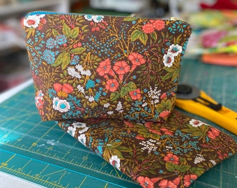 Up-cycled vintage upholstery fabric makeup bag. Made from unused fabric ends. Cosmetics, essentials, small travel tote.
