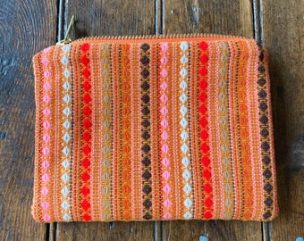 Upcycled vintage 70's wool and bark cloth zip bag from repurposed fabric ends lined with vintage linen prints, 7x5 inches.