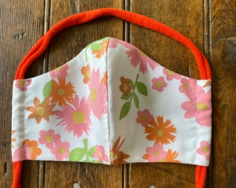 Womens/Teens reversible mask from vintage sheet 60's fabrics in floral cottons with orange colored tshirt cording tie.