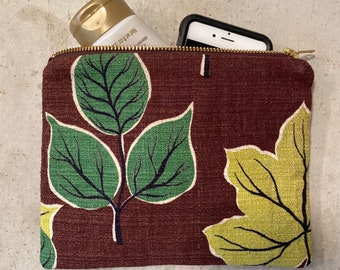 Large upcycled bark cloth zipper purse from repurposed 70's fabric ends lined with vintage floral fabric, 8.5x6.5 inches.