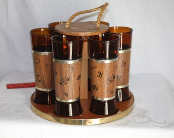Western motif Siesta Ware tumblers with walnut jackets and carry along and storage tray