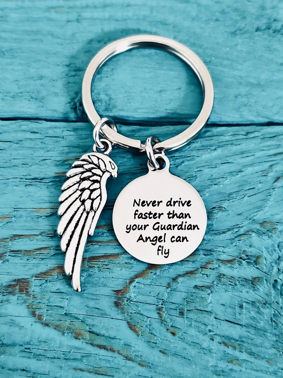 Angels Wing Key Ring inscribed Never drive faster than your angel can fly.