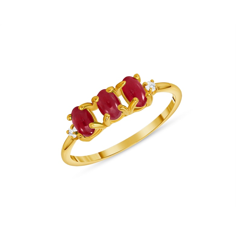 14k solid gold three stone Ruby and diamond ring.