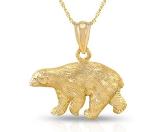 "14k solid gold polar bear pendant on a solid gold 18"" chain."
