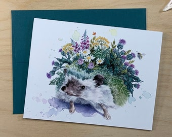 Greeting card, hedgehog with wildflowers.