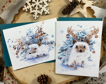 Pack of two greeting cards, hedgehog with fir branches and Christmas decorations.