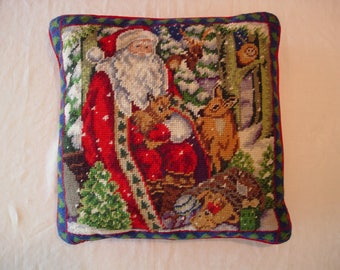Needlepoint Christmas Pillow of Santa Claus Sitting in the Woods Surrounded by Animals of the Forrest and a Bag of Toys at His Feet