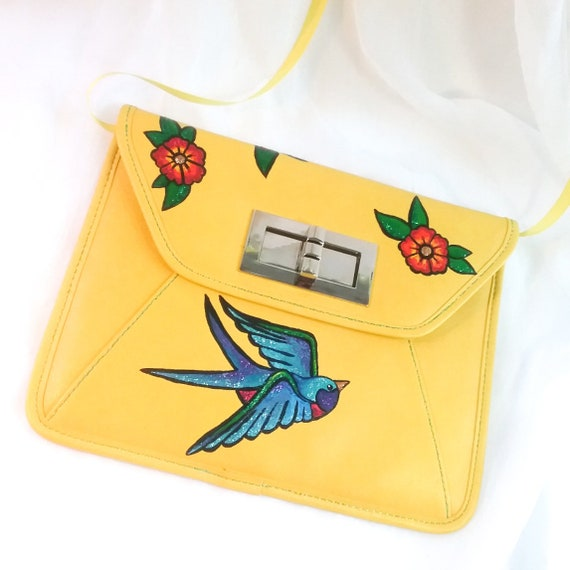 a ladylike handbag for a daring and outrageous soul Mitzi/'s Cunning Clutch