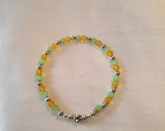 Green and yellow stretch bracelet
