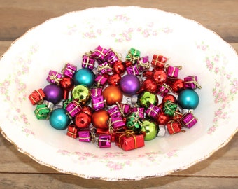lot of tiny gifts miniature christmas ornaments feather tree ornaments and mini presents