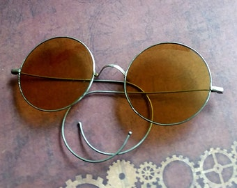 57f5bc1a60f0 Round Amber Lens Antique Sunglasses. Manufactured by Willson. In Good  Condition with Some Wear. Comes with Postage Stamped Shipping Box.