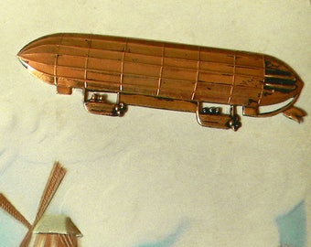 100+ Year Old Airship Dirigible Postcard. Beautiully Embossed w/Mounted Metal Stamping Airship Insignia. Made in Germany. Postmarked 1908.