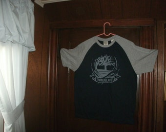 Timberland size XS/TP short sleeve Navy blue with big gray sleeves
