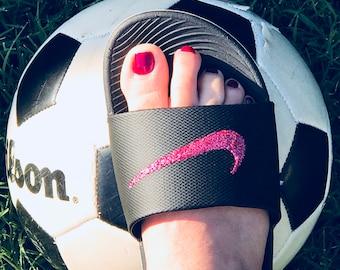 Women s Nike Benassi JDI Slide in black with hot pink glitter swoosh 1da2928307