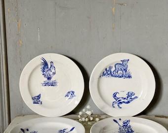 A a set of four miniature child's Ironstone blue transferware antique tea plates