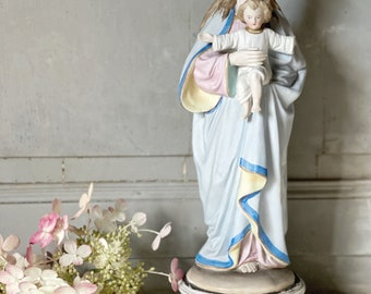 An antique religious figure of the Madonna and Child