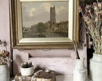 A beautiful antique oil on board  painting by Artist D J MacNiel of a Church Tower And River Scene