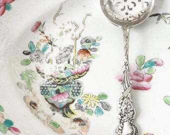 An elegant silver plated sugar sifter spoon