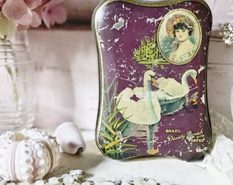 A beautiful unusual antique toffee tin with Pretty swans