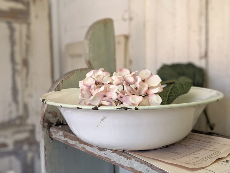 A pretty antique white enamel bowl image 0