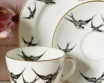 A striking vintage bone China teacup and saucer with swallows