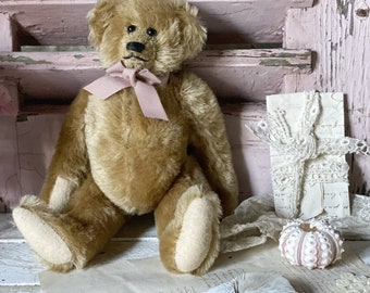 A gorgeous vintage jointed teddy bear
