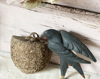 A rare hand carved Black Forest swallow and nest