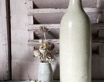 A lovely large antique French pottery bottle