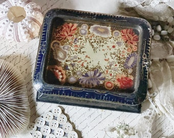 A beautiful unusual vintage toffee tin with Japanese decoration