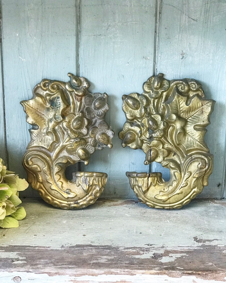 A pair of French mirror image metal antique finials image 0
