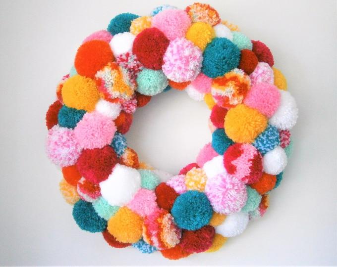 Featured listing image: Large Multi Coloured Yarn Pom Pom Wreath/Party Decor/Christmas Wreath/Home Decor/Modern Wreath/Bohemian Home Decor/Colourful Wreath/Wreath