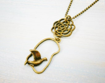 Antique Bronze Necklace with Filigree Flower and Bird Charm/Boho Necklace/Nature Necklace