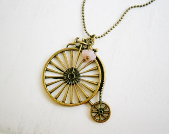 Antique Bronze Penny Farthing Bike Necklace with Pink Flower Bead Drop on Antique Bronze Ball Chain/Boho Necklace.