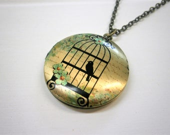 Vintage Style Picture Locket Necklace/Antique Bronze Locket with detailed Photo of a Bird in a Vintage Style Cage/Long Necklace.