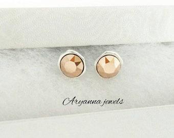 Earring swarovski rose gold.