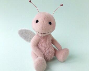Pink Cuddlebug art toy